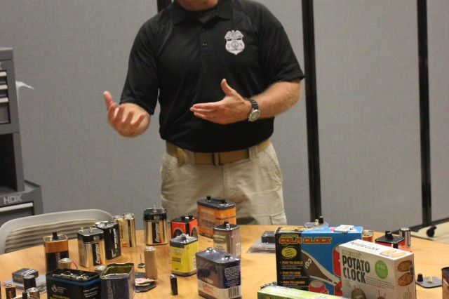 "ATF special agent Michael Knight shows power sources that could be either for everyday use or for an explosive device. During an incident, authorities have to determine ""what is normal and what is not normal,"" he said."