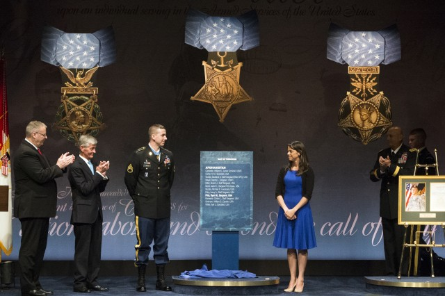 Former Staff Sgt. Ryan M. Pitts, Medal of Honor recipient, is inducted into the Hall of Heroes during a Pentagon ceremony, July 22, 2014. From left to right are: Deputy Defense Secretary Robert Work, Army Secretary John M. McHugh, Pitts and his wife Amy, Secretary of the Army Gen. Ray Odierno, and, Sgt. Maj. of the Army Raymond F. Chandler III.