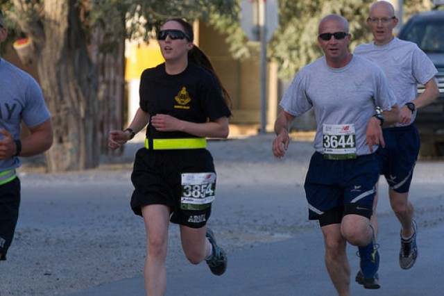 1st Lt. Justina Sisler races to the finish of the Run to Home Base 10K at Bagram Airfield, Afghanistan, July 18. Sisler placed second in the female category.