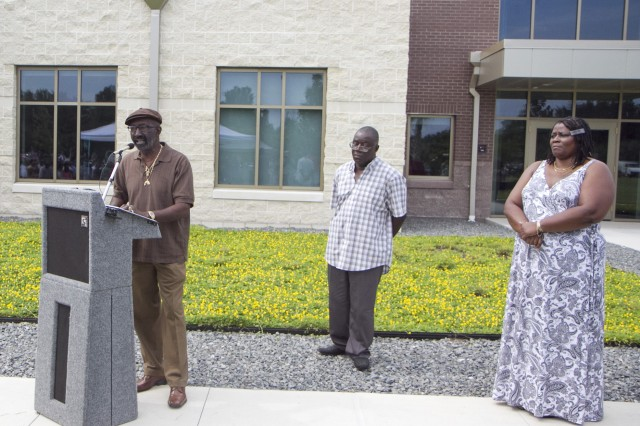 Tracy Cashe speaks during a memorialization ceremony renaming an Army Reserve center in honor of his brother, the late Sgt. 1st Class Alwyn C. Cashe on July 19 in Sanford, Fla. Cashe died from injuries sustained while rescuing fellow troops from a burning vehicle in Diyala, Iraq, in 2005. Also pictured are Karlos Cashe, center, and Kasinal Cashe White, brother and sister to the honoree.