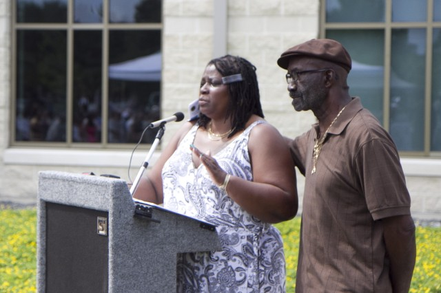 With the support of her brothers, Tracy and Karlos, Kasinal Cashe White speaks during a memorialization ceremony renaming an Army Reserve center in honor of her brother, the late Sgt. 1st Class Alwyn C. Cashe, on July 19 in Sanford, Fla. Cashe died from injuries sustained while rescuing fellow troops from a burning vehicle in Diyala, Iraq, in 2005. Cashe has been recommended for the Medal of Honor.