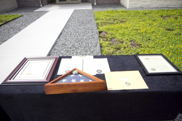 The numerous proclamations, commemorative coins and letters that were presented to the Cashe family are pictured at a memorialization ceremony in Sanford, Fla., where the new Army Reserve Center was renamed in memory of Sgt. 1st Class Alwyn C. Cashe, a Silver Star recipient from Oviedo who died Nov. 8, 2005, after heroically rescuing his fellow Soldiers from a burning Bradley Fighting Vehicle. Cashe is currently being recommended for the Medal of Honor.