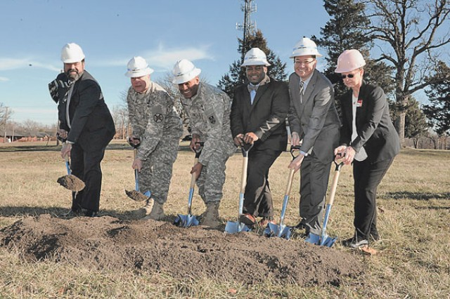 From left to right: Bobby Rakes, Directorate of Public Works director; Col. William Pfeffer, Garrison commander; Maj. Gen. Leslie Smith, Maneuver Support Center of Excellence and Fort Leonard Wood commander; Will Radford, Lend Lease development manager, Arthur Holst, IHG operations vice president; and Susan Sielky, IHG Fort Leonard Wood general manager, break ground for construction to begin on the new Candlewood Suites hotel. Candlewood Suites is projected to be finished in fall of 2015. The hotel will replace the Sturgis facility.
