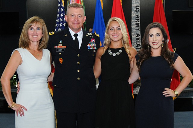 Maj. Gen. Michael D. Lundy with his wife, Paula, and daughters, Sydnie and Kacie, after the Family pinned on his new rank during a ceremony at the U.S. Army Aviation Museum July 22.