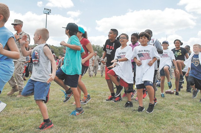 Participants and volunteers run in place prior to starting the St. Louis Rams' NFL Play 60 event at Gerlach Field. More than 300 participants between the ages of 3 and 18 took part.