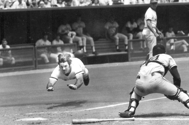 Pete Rose shown sliding into home base, a practice that earned him the nickname of Charlie Hustle. Rose debuted in 1963 and finished his career in 1986, including a period of time when he served in the Army Reserves.