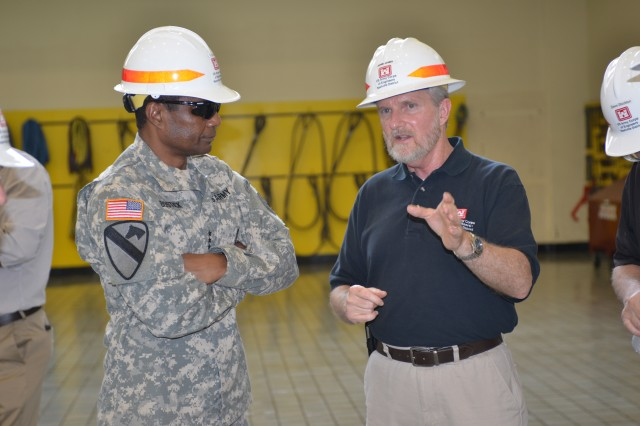 Jamie James, U.S. Army Corps of Engineers Nashville District Hydropower Program manager, briefs Lt. Gen. Thomas P. Bostick, USACE commander and chief of engineers, during a tour at the Center Hill Dam Power Plant July 22, 2014. (Photo by Mark Rankin)