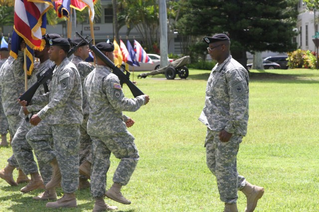 Command Sgt. Maj. Bryant Lambert, the new senior enlisted advisor for U.S. Army Pacific marches the colors detachment during a change of responsibility ceremony held at Palm Circle, July 24.