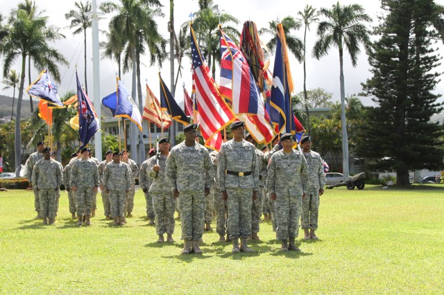 FORT SHAFTER, Hawaii—Gen. Vincent Brooks, U.S. Army Pacific commanding general (center), Command Sgt. Maj. Frank Leota (right), USARPAC's out-going senior enlisted advisor and Command Sgt. Maj. Bryant Lambert (left), USARPAC's in-coming senior enlisted advisor, take their positions during the change of responsibility ceremony held at Fort Shafter's historic Palm Circle, July 24. Leota relinquishes his responsibility to Lambert after 34 years of service. (U.S. Army photo by Staff Sgt. Kyle J. Richardson, USARPAC PAO)