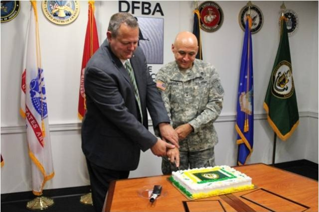 Donald Salo, director the Defense Forensics and Biometrics Agency, and Army Provost Marshall General Maj. Gen. Quantock cut the cake to celebrate uncasing of colors, July 23, 2014, in Washington, D.C.