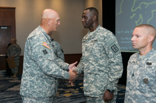 Gen. Ray Odierno, Army chief of staff, congratulates Sgt. 1st Class Michael Brown, with the U.S. Army Quarter Master Corps, Fort Lee, Va., for earning one of the first seven Army Instructor Badges, during a ceremony July 17, 2014, in Alexandria, Va.