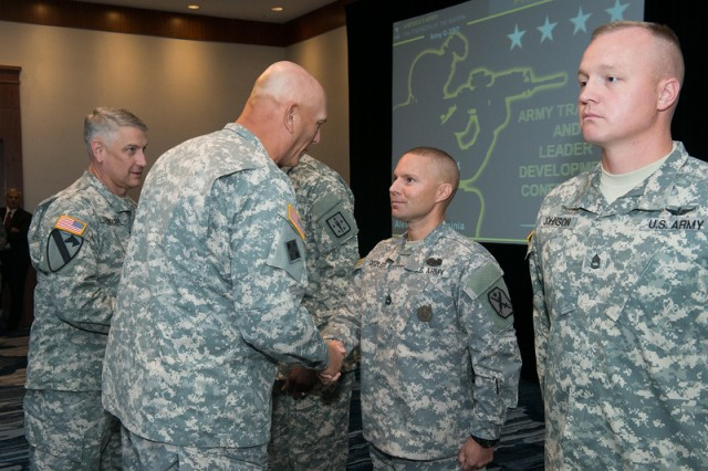 Gen. Ray Odierno, Army chief of staff, congratulates Sgt. 1st Class Brian Ditzler, with the U.S. Army Maneuver Center of Excellence, Fort Benning, Ga., on receiving one of the first Army Instructor Badges, during a ceremony July 17, 2014, in Alexandria, Va.