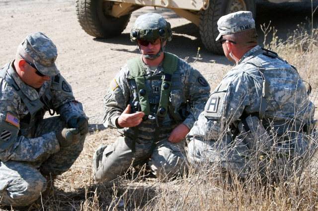 Staff Sgt. Joshua Elmer (right), an observer coach/trainer with First Army Division West's 189th Infantry Brigade, conducts an after action review with a convoy commander and another Soldier during a Warfighter Exercise at Fort Hunter-Liggett, Calif., on July 21. The exercise involved units from all three Army components: active duty, National Guard and Reserve.