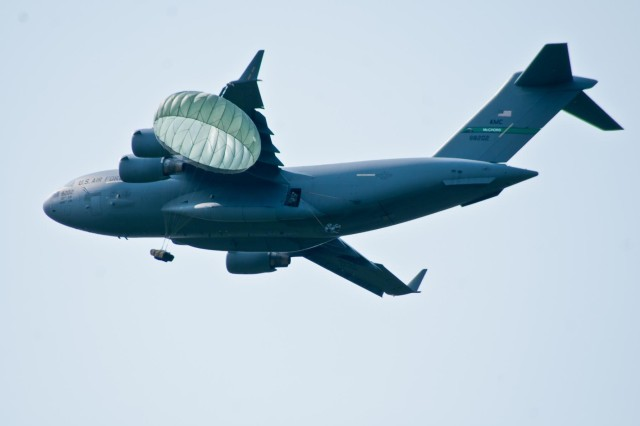 Paratroopers with the 4th Infantry Brigade Combat Team (Airborne), 25th Infantry Division, jump from a U.S. Air Force C-17 Globemaster onto Malemute Drop Zone during a training parachute assault on Joint Base Elmendorf-Richardson, Alaska, July 21, 2014. More than 400 paratroopers and equipment will fill the skies each day over Malemute through Wednesday as part of a partnership training event with members of the U.S. Air Force from Joint Base Lewis-McChord, Wash. and Joint Base Pearl Harbor-Hickam, Hawaii. (Photo by U.S. Army Sgt. Eric-James Estrada/Released)