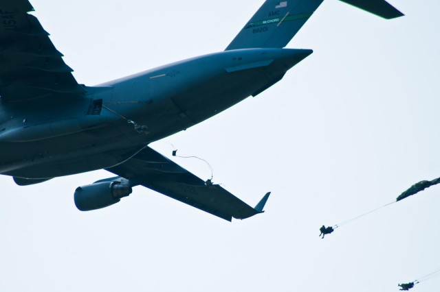 Paratroopers with the 4th Infantry Brigade Combat Team (Airborne), 25th Infantry Division, jump from a U.S. Air Force C-17 Globemaster onto Malemute Drop Zone during a training parachute assault on Joint Base Elmendorf-Richardson, Alaska, July 21, 2014. More than 400 paratroopers and equipment will fill the skies each day over Malemute through Wednesday as part of a partnership training event with members of the U.S. Air Force from Joint Base Lewis-McChord, Wash., and Joint Base Pearl Harbor-Hickam, Hawaii. (Photo by U.S. Army Sgt. Eric-James Estrada/Released)