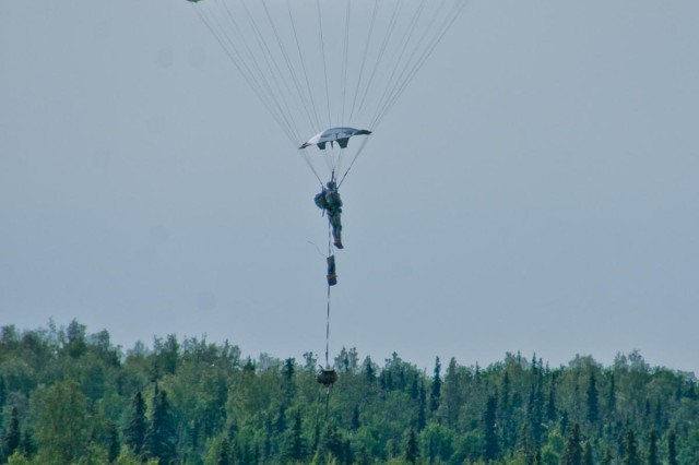 A paratrooper with the 4th Infantry Brigade Combat Team (Airborne), 25th Infantry Division, prepares to land onto Malemute Drop Zone after jumping from a U.S. Air Force C-17 Globemaster during a training parachute assault on Joint Base Elmendorf-Richardson, Alaska July 21, 2014. More than 400 paratroopers and equipment will fill the skies each day over Malemute through Wednesday as part of a partnership training event with members of the U.S. Air Force from Joint Base Lewis-McChord, Wash., and Joint Base Pearl Harbor-Hickam, Hawaii.  (Photo by U.S. Army Sgt. Eric-James Estrada/Released)