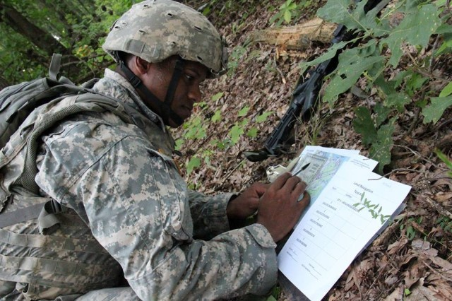 Staff Sgt. Keith Thomas from the 52nd EOD Group participates in a land navigation test during the 20th CBRNE Command Best Warrior Competition on Aberdeen Proving Ground, Maryland July 22.