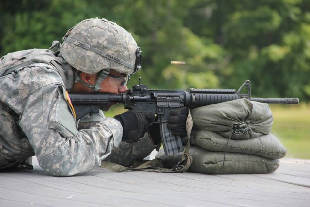 Spc. Dallas Poulson from the 71st EOD Group participates in a marksmanship test during the 20th CBRNE Command Best Warrior Competition on Aberdeen Proving Ground, Maryland July 22.
