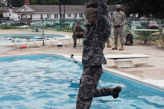 Spc. Kyle Schultheis from the 52nd EOD Group participates in a water survival test during the 20th CBRNE Command Best Warrior Competition on Aberdeen Proving Ground, Maryland July 24.