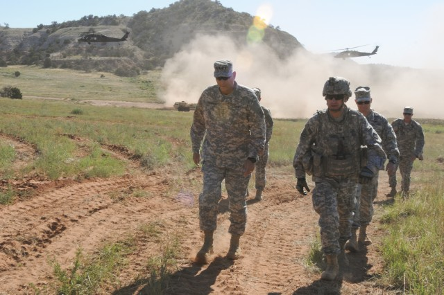 Gen. Raymond T. Odierno, left, chief of Staff of the Army, walks with Col. Gregory F. Sierra, commander, 3rd Armored Brigade Combat Team, 4th Infantry Division, at Camp Red Devil on Fort Carson, Colo., July 24, 2014. Odierno watched 3rd ABCT Soldiers perform a situational training exercise focused on conventional warfare.