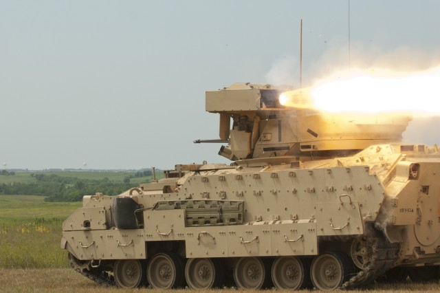 The crew of an M2A3 Bradley Fighting Vehicle fire a tube-launched, optically-tracked, wire-guided, or TOW, anti-tank missile July 22 on Fort Riley's training areas. The 1st Bn., 63rd Armor Regt., 2nd ABCT, 1st Inf. Div., was the first Fort Riley unit to fire live TOWs in more than a decade.