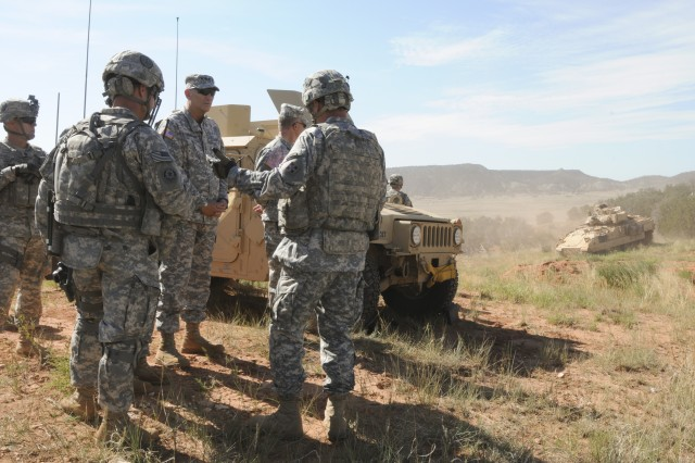 Gen. Raymond T. Odierno, chief of Staff of the Army, talks with leaders from 3rd Armored Brigade Combat Team, 4th Infantry Division, at Camp Red Devil, Fort Carson, Colo., July 24, 2014. Odierno watched 3rd ABCT Soldiers perform a situational training exercise focused on conventional warfare.