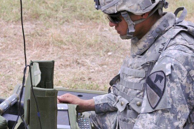 Combat engineer Spc. Jacob Aveila of San Antonio, prepares his radio control unit to identify munitions control units, all part of the M7 Spider networked mine system training on Fort Hood, Texas. Aveila is assigned to the 3rd Brigade Engineer Battalion, 3rd Brigade Combat Team, 1st Cavalry Division. (U.S. Army photo by Staff Sgt. Chuck Burden, 3rd BCT PAO, 1st Cavalry Division)