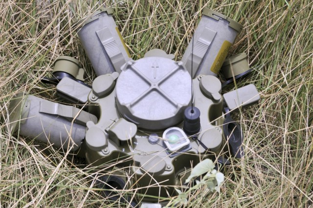 """The M7 Spider networked mine system allows operators to choose between discharging lethal or non-lethal munitions. One grenade """"can be launched 2 meters high, out 5 to 7 meters, with a 10-meter blast radius, each grenade capable of up to 1,400 fragments,"""" said Joe Carr, a training instructor for the munitions new equipment training branch at the Army Armament Research, Development and Engineering Center in Picatinny Arsenal, N.J. (U.S. Army photo by Staff Sgt. Chuck Burden, 3rd BCT PAO, 1st Cavalry Division)"""