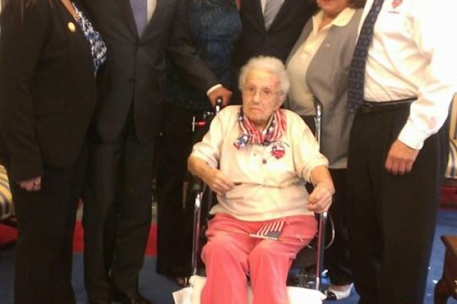 """America's sweetheart, Lucy Coffey, 108-year-old WWII veteran went from Texas to the White House!,"" reads the caption of this picture posted on the Honor Flight Austin's Facebook page capturing the veteran's arrival at the White House, July 25, 2014."