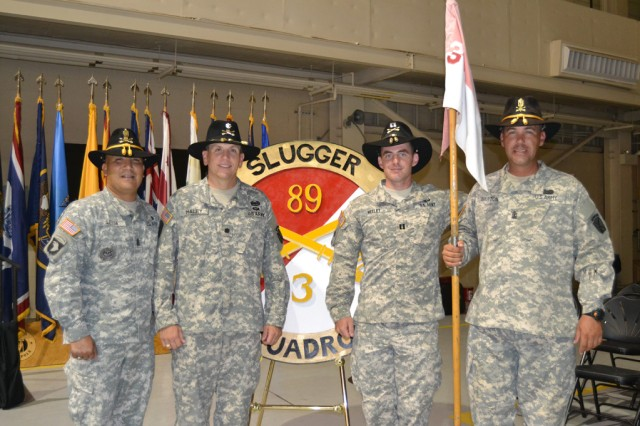 """FORT POLK, La. -- From left: Command Sgt. Maj. Antonio Leija and Lt. Col. Gregg Haley, command team 3rd Squadron, 89th Cavalry Regiment and Capt. Benjamin Neeley and 1st Sgt. Jason Barton, command team Troop A, 3rd Sqdn, 89th Cav. Reg.  The two command teams stood together after Troop A's homecoming ceremony in 5th Aviation Battalion's hanger, July 25, 2014. Troop A returned from a nine month deployment to Cuba. """"What's important to me is that we've got our team back together, we've got over 130 soldiers redeploying they're back with their loved ones and their Army family,"""" said Haley. 3rd Sqdn. """"I'd like to thank them for their hard word for nine months… we're going to transition and get back to the Slugger mission of doing cavalry operations in support of 4th Brigade Combat Team, 10th Mountain Division. (U.S. Army photo by: Sgt. 1st Class E. L. Craig, 4th BCT, 10th MTN DIV Public Affairs)"""