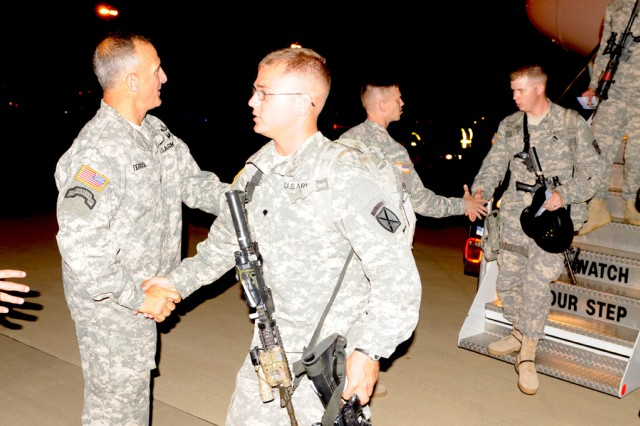 FORT POLK, La. -- U.S. Army Command Sgt. Maj. Michael Ferrusi (left), senior enlisted leader, 4th Brigade Combat Team, 10th Mountain Division welcomes Troop A Soldiers at Alexandria International Airport in Louisiana, July 25, 2014. Troop A returned from a nine month deployment to Cuba. Troop A belongs to 3rd Squadron, 89th Cavalry Regiment, part of 4th BCT, 10th Mtn. Div. (U.S. Army photo by: Spc. Anri Baril, 4th BCT, 10th MTN DIV Public Affairs)