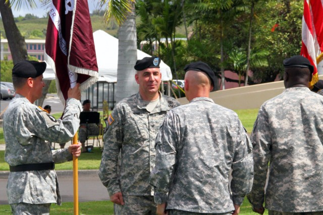 Col. David Dunning (center) assumed command of TAMC from Brig. Gen. Dennis Doyle (left), Commanding General of Pacific Regional Medical Command and outgoing TAMC Commander during a Change of Command and Change of Responsibility ceremony July 25, 2014 at 10 a.m. at the TAMC Flag Pole.