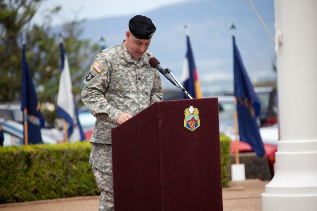 Col. David Dunning, incoming Tripler Army Medical Center (TAMC) Commander addresses his new staff during the Change of Command and Change of Responsibility ceremony where he assummed command of TAMC from Brig. Gen. Dennis Doyle, Commanding General of Pacific Regional Medical Command (PRMC) July 25, 2014 at the TAMC Flag Pole in Honolulu, Hawaii.