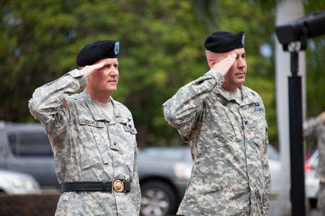 Col. David Dunning (right) incoming Tripler Army Medical Center (TAMC) Commander, presents arms alongside Brig. Gen. Dennis Doyle, Commanding General for Pacific Regional Medical Command (PRMC) and outgoing TAMC Commander during a Change of Command and Change of Responsibility ceremony July 25, 2014 at 10 a.m. at the TAMC Flag Pole.