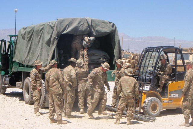 Soldiers help load tents into a truck for the Ministry of Interior Highway Brigade July 18 at Bagram Air Field, Afghanistan.