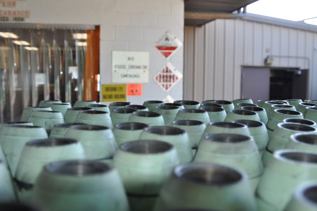 A pallet of munitions prepped for demilitarization sits outside of Crane Army Ammunition Activity's white phosphorus-to-phosphoric acid conversion plant July 22, 2014. The plant operates 24 hours a day, seven days a week and has a maximum capability of processing up to 11,500 pounds of white phosphorus in a day, producing 48,000 pounds of phosphoric acid with a 75 percent concentration.