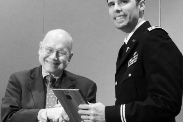 Dr. John M. Templeton, Jr., presents the Drs. John M., Jr. and Josephine J. Templeton Lecture Award to Major (Dr.) Christian Labra who's experience as an injured artillery officer in Iraq led him to become an Army doctor who is now serving at Landstuhl Regional Medical Center.