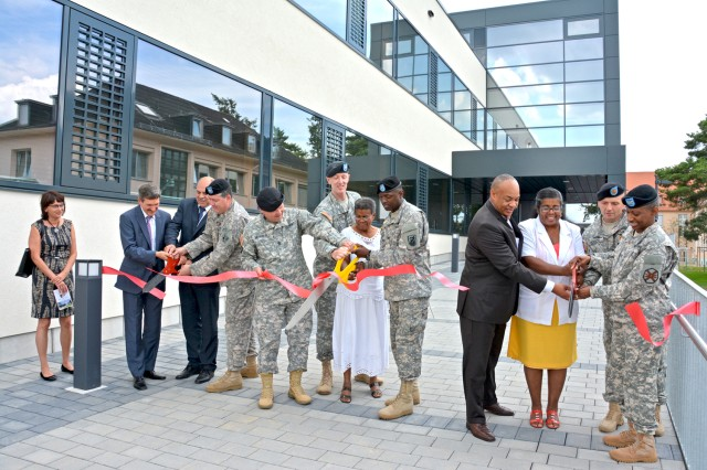 Members of the Gray family join German and American civilian and military officials in cutting the ribbon to open the Lt. Gen. Robert E. Gray Cyber Center Europe on Wiesbaden's Clay Kaserne July 22.