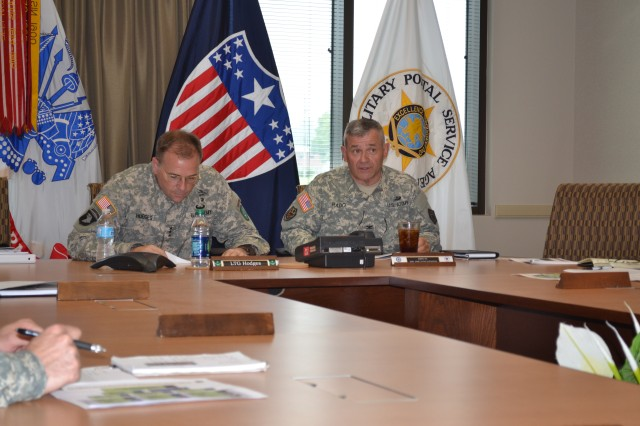 "Col Mark A. Rado, Deputy, The Adjutant General of the US Army briefs Lt. Gen. Frederick B. ""Ben"" Hodges, Commander, North Atlantic Treaty Organization's Allied Land Command on the many ways HRC supports Soldier in the field from evaluations, promotion boards to educational support at the Maude Complex, Fort Knox, Kentucky July 18, 2014"