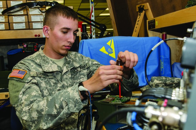 Pfc. Taylor Steffen repairs a Single Channel Ground and Airborne Radio System (SINCGARS) Radio Transmitter at Tobyhanna Army Depot. Steffen is a member of the Communication and Electronics Repair Section of the 322nd Support Maintenance Company, Arden Hills, Minn.