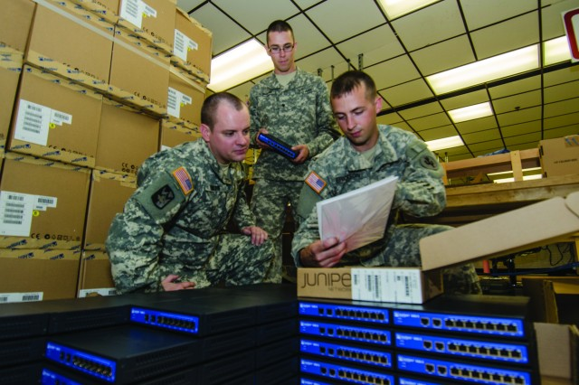 Staff Sgt. Scott Benson, Spc. Daniel Steinbruckner and Pfc. Taylor Steffon review packaging information for SINCGARS Radio Transmitters at Tobyhanna Army Depot. They are members of the Communication and Electronics Repair Section of the 322nd Support Maintenance Company, Arden Hills, Minn.