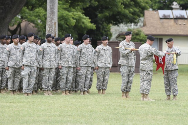 Capt. Scott King and 1st Sgt. Delmont Stephens, 70th Engineer Company (Geospatial) command team, case the company's colors during a deactivation ceremony on Hamilton Field July 25.  The company traces its lineage back 70 years and has participated in numerous deployments in support of Operation Iraqi Freedom.  (U.S. Army photo by Capt. Laura Beth Beebe, 130th Engineer Brigade, 8th Theater Sustainment Command Public Affairs/Released)