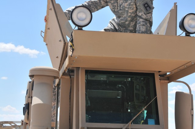 Lt. Gen. Michael Tucker, First U.S. Army commanding general, climbs in the cab of a Husky route clearance vehicle used by 3rd Battalion, 364th Engineer Regiment, Task Force Rampant, 5th Armored Brigade, Division West, for training exercises at McGregor Range, N.M., Sept. 5, 2013.