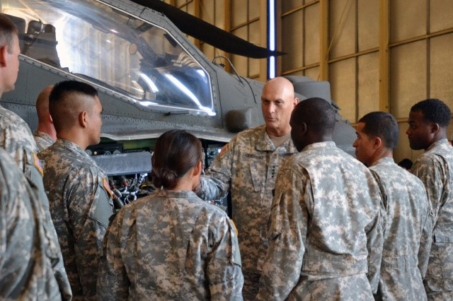 FORT CARSON, COLO. -- Army Chief of Staff Gen. Raymond T. Odierno, middle, talks to AH-64 Apache maintainers from 4th Combat Aviation Brigade, 4th Infantry Division, at Butts Army Airfield hangars on Fort Carson, Colo., July 24, 2014.   (Photo by Sgt. Jonathan C. Thibault, 4th Combat Aviation Brigade Public Affairs Office, 4th Infantry Division/Released