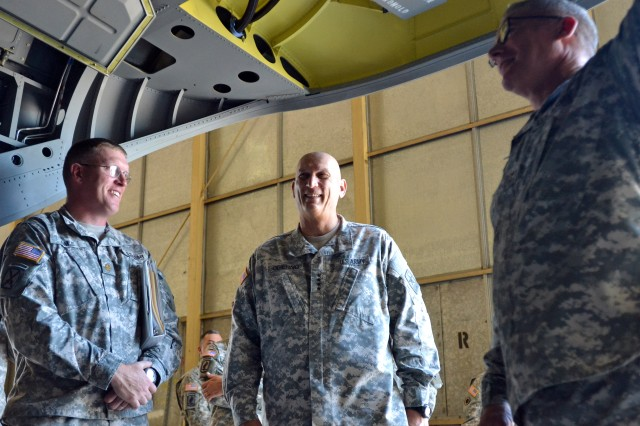 FORT CARSON, COLO. -- Army Chief of Staff Gen. Raymond T. Odierno, middle, and Commanding General Maj. Gen. Paul J. LaCamera, right, 4th Infantry Division and Fort Carson, are given a tour of CH-47F Chinook by Maj. Michael Hale, left, executive officer and Chinook pilot, 4th Combat Aviation Brigade, 4th Inf. Div., at Butts Army Airfield hangars on Fort Carson, Colo., July 24, 2014.(Photo by Sgt. Jonathan C. Thibault, 4th Combat Aviation Brigade Public Affairs Office, 4th Infantry Division/Released)