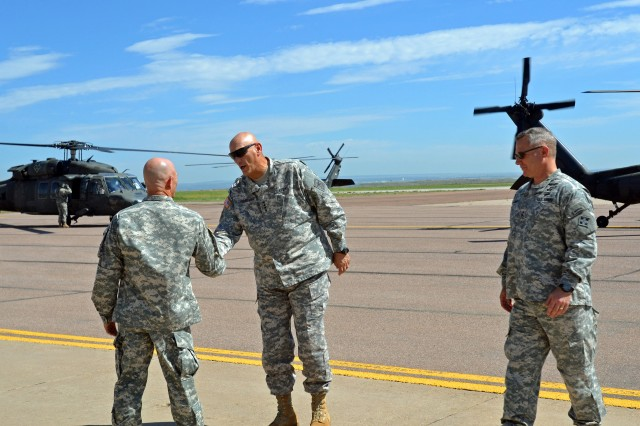 FORT CARSON, COLO. -- Army Chief of Staff Gen. Raymond T. Odierno, middle, and Commanding General Maj. Gen. Paul J. LaCamera, right, 4th Infantry Division and Fort Carson, are greeted by Col. Robert T. Ault, left, commander, 4th Combat Aviation Brigade, 4th Inf. Div.,  at Butts Army Airfield on Fort Carson, Colo., July 24, 2014.(Photo by Sgt. Jonathan C. Thibault, 4th Combat Aviation Brigade Public Affairs Office, 4th Infantry Division/Released)