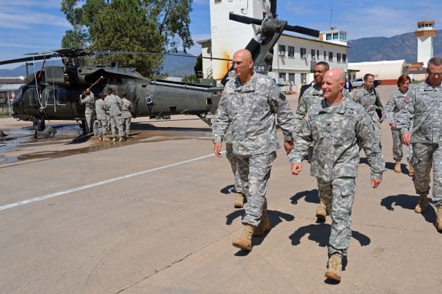 FORT CARSON, COLO. -- Army Chief of Staff Gen. Raymond T. Odierno, left, is given a tour by Col. Robert T. Ault, right, commander, and Command Sgt. Maj. Antoine Duchatelier Jr., middle, command sergeant major, both leaders of 4th Combat Aviation Brigade, 4th Infantry Division,  at Butts Army Airfield on Fort Carson, Colo., July 24, 2014.(Photo by Sgt. Jonathan C. Thibault, 4th Combat Aviation Brigade Public Affairs Office, 4th Infantry Division/Released)