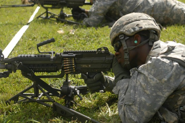 A Soldier with Headquarters and Headquarters Company, 8th Special Troops Battalion, qualifies with his M249 during a range at Schofield Barracks, Hawaii. (U.S. Army photo courtesy of Headquarters and Headquarters Company, 8th Special Troops Battalion/Released)
