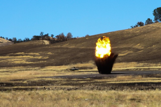 Soldiers from the 744th Engineer Battalion, 744th Engineer Company and 368th Engineer Battalion detonate 45 pounds of high-intensity explosives known as C-4 July 24, 2014, at Fort Hunter Liggett, Calif. (U.S. Army Reserve Photo by Pfc. Brian N. Lang / 205TH Press Camp Headquarters)