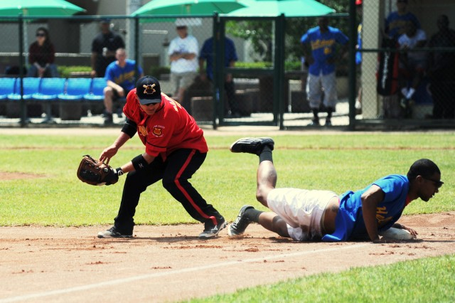 A Soldier slides onto base in a close play during the Area I Memorial Day Softball Tournament, held May 23 - 26 on Camp Red Cloud in Uijeongbu, South Korea.
